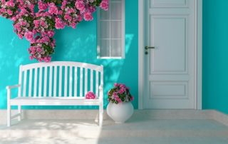 beautiful bright blue entryway with flowers